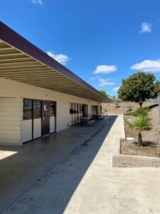Chino Hills - CVUSD Alternative Education Center - building photo with picnic tables near building