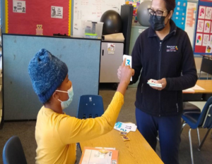 Mission Valley - masked student interacting with masked instructor