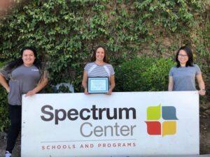 San Jose campus staff with sign and award