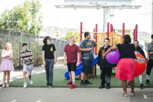 Students lined up near playground outside