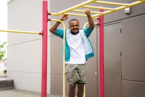 Student playing on outdoor monkey bars