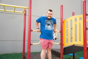 Student playing on playground equipment