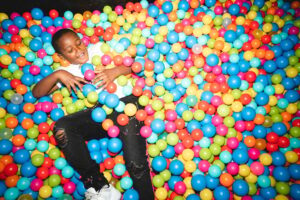 Student playing in ball pit at Tara Hills campus