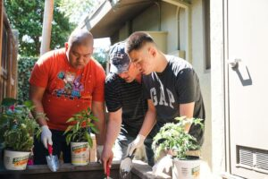 Students and instructor gardening together